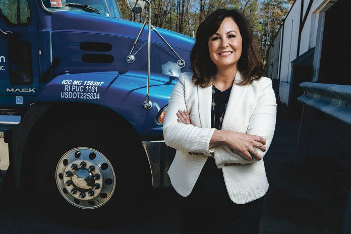 KEEP ON TRUCKING: Elizabeth Robson started on the lowest rung of her family's business, JF Moran, decades ago and worked her way up – including earning a law degree – until she was named president in 2015. She also teaches at Johnson & Wales University.  / PBN PHOTO/RUPERT WHITELEY