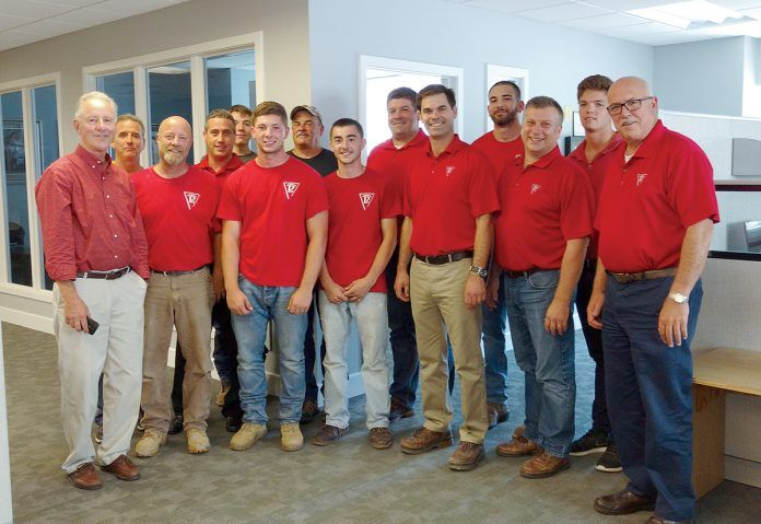 MATCH DAY: Members of the Pariseault Builders staff at the company headquarters in Warwick.  / COURTESY PARISEAULT BUILDERS