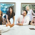 STRATEGY SESSION: Navigant employees, from left: Ross Silva, assistant vice president for business development and loan officer; Megan Birch (hidden), mortgage loan supervisor; Lee Conte, loan officer; David DeCubellis, vice president of residential mortgages; Deb Drechnowicz, mortgage underwriter; and Alisha Tierney, mortgage-support coordinator. / PBN PHOTO/RUPERT WHITELEY