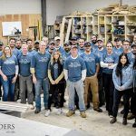 GROUP GATHERING: The staff of Sweenor Builders at the company workshop in the Wakefield section of South Kingstown. / COURTESY SWEENOR BUILDERS