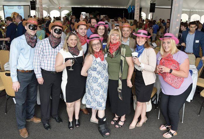 COWBOYS AND ACCOUNTANTS: DiSanto, Priest & Co. staff members don matching hats for the 2018 PBN Best Places To Work awards dinner.  / COURTESY DISANTO, PRIEST & CO.