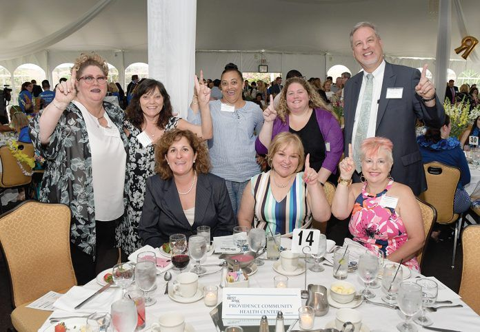 PRIDE OF PLACE: Providence Community Health Centers staff members say they're No. 1 at the 2018 PBN Best Places To Work awards dinner.  / COURTESY PROVIDENCE COMMUNITY HEALTH CENTERS