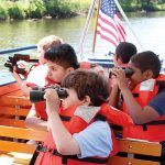 SEEING SIGHTS: Children enjoy the RiverClassroom on the Blackstone River, a program supported by the Narragansett Bay Commission. / COURTESY NARRAGANSETT BAY COMMISSION