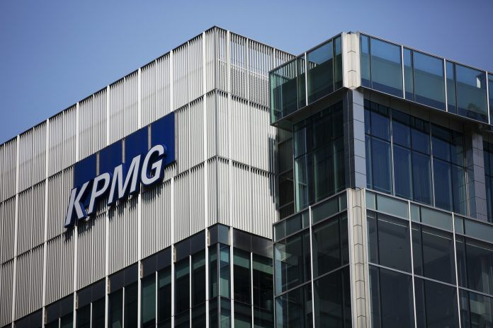 KPMG LLP will pay $50 million to settle Securities and Exchange Commission allegations that it altered past audit work after receiving stolen information from an industry watchdog. / BLOOMBERG NEWS FILE PHOTO/SIMON DAWSON