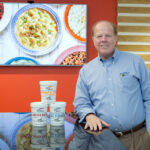 FOOD AND FOUNDATION: Not only does Blount Fine Foods Executive Vice President Bob Sewall travel the country promoting Blount products, he started his own charity to help the needy.  / PBN PHOTO/KATE WHITNEY LUCEY