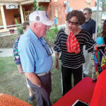 GOOD FIT: Ruth Thumbtzen, an AARP member, speaks with Brian Martin of Middletown last month after the ribbon-cutting for a new fitness park in Newport. / COURTESY JOHN MARTIN/AARP