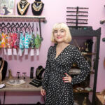 CUSTOM DESIGNS: Brianna Moon, CEO and designer of Brianna Moon custom apparel and jewelry, opened a space in the Hope Artiste Village in Pawtucket in June to sell her creations. / PBN PHOTO/MICHAEL SALERNO