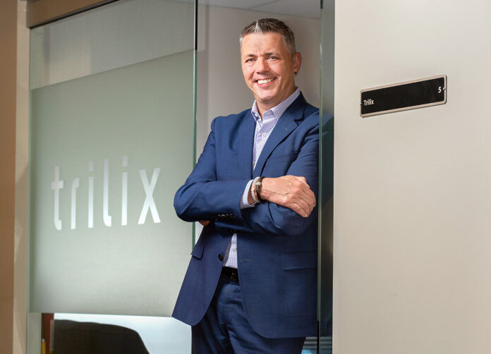 SELF-STARTER: Tim Hebert's first business venture went from a two-person startup to a $170 million, 300-employee company. In 2017, he started something new: Trilix LLC, a software development and business intelligence company. / PBN PHOTO/DAVE HANSEN