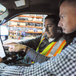 PLANNING AHEAD: Nate Fiske, right, Case Snow Management Inc. regional director of operations, and shop foreman Ken Maynard equip one of the company's trucks with a tablet loaded with Case's management software.PBN PHOTO/RUPERT WHITELEY