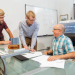 EFFICIENCY EXPERTS: Aquanis Inc. CEO Neal E. Fine, right, Chief Technology Officer John A. Cooney, center, and Senior Mechanical Engineer Christopher Szlatenyi are working on turbine blade designs that would make them more efficient.PBN PHOTO/DAVE HANSEN