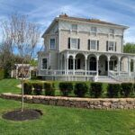CHERYL HACKETT and John Grosvenor will be honored with the Rhody Awards Historic Homeowner Award for the restoration of the Restmere property in Middletown, pictured above. / COURTESY NEWPORT RESTORATION FOUNDATION