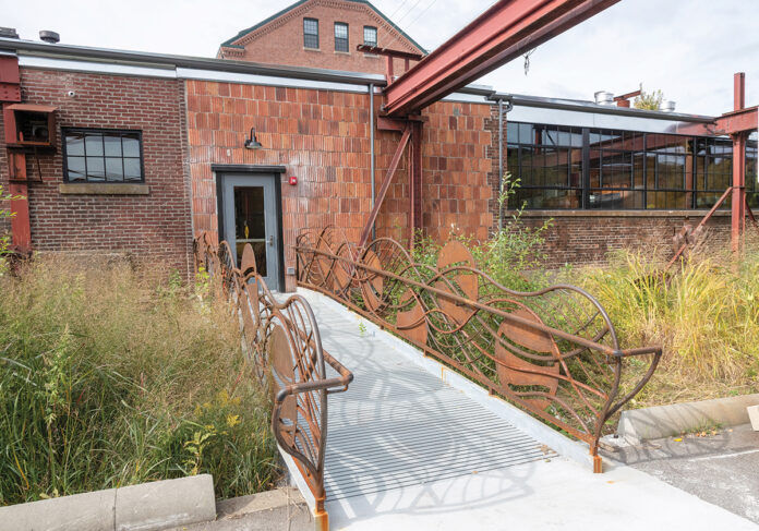 GROOVY EXTERIOR: The exterior of the Public Projects area is newly clad in corrugated steel. The material that was removed was used on the interior. /  PBN PHOTO/MICHAEL SALERNO