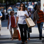 THE UNIVERSITY OF MICHIGAN consumer sentiment index to a three-month high of 96 from September's 93.2. / BLOOMBERG NEWS FILE PHOTO/VICTOR J. BLUE