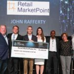 RETAIL MARKETPOINT was selected as the winner of Cox Business' Get Started Rhode Island bsuiness pitch competition. Above, from left: Ross Nelson, vice president, Cox Business; Mike Ritz, moderator, and executive director of Leadership Rhode Island; John Rafferty, founder of Retail MarketPoint; Shannon Shallcross, co-founder and CEO, BetaXAnalytics; Arnell Milhouse, co-founder and CEO, CareerDevs Computer Science University; Patrice M. Milos, co-founder, CEO and president, Medley Genomics; and Karl Wadensten, CEO and president, VIBCO Vibrators. / COURTESY COX BUSINESS