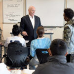 LIFE SKILLS: Stephen Cronin, a sales executive with Signature Printing in East Providence, volunteers at Hope High School in Providence, teaching students interpersonal and research skills desired by employers. / PBN PHOTO/MIKE SKORSKI