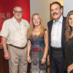 BALANCED GROWTH: From left, Carl Coutu, Jo Anne Samborsky, Joseph Dias and Jennifer Bove, franchise owners of Keller Williams Central Rhode Island in Cranston. Coutu, who purchased the location in 2011 and is stepping down as operating principal, will be succeeded by Bove. / PBN PHOTO/MICHAEL SALERNO