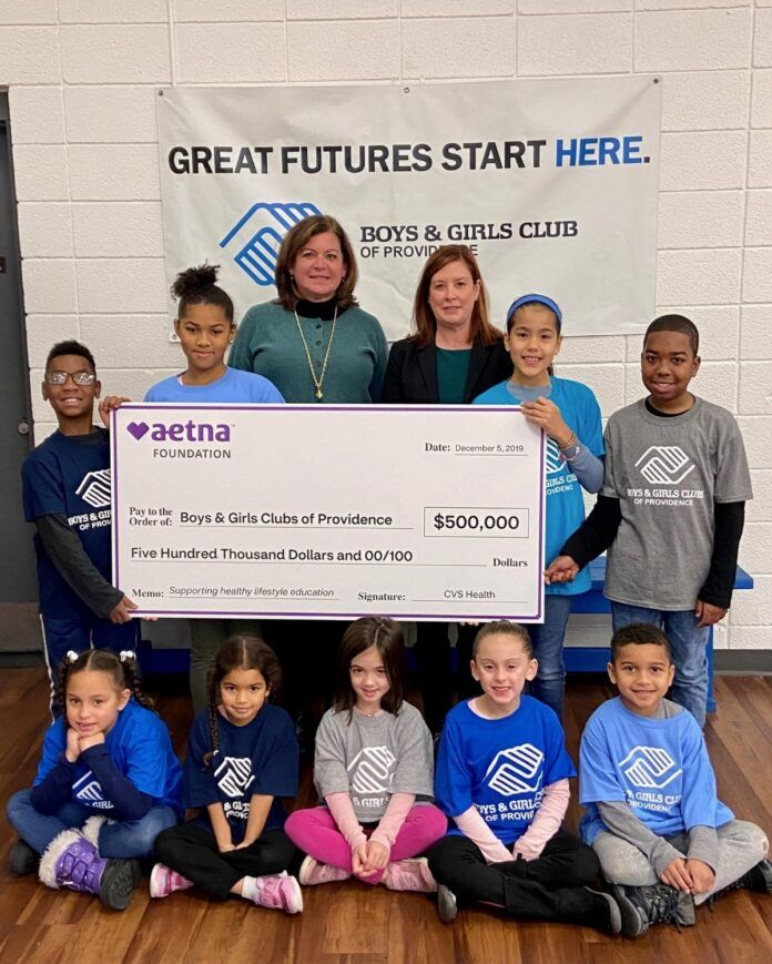 $500,000 grant from the Aetna Foundation to Nicole Dufresne, CEO of the Boys & Girls Clubs of Providence. The grants will support efforts to prevent youths from misusing tobacco drugs and alcohol and from engaging in premature sexual activity. / COURTESY AETNA FOUNDATION
