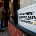 U.S. JOB CUTS totaled 32,843 in December, a 25% decline year over year. / BLOOMBERG NEWS FILE PHOTO/JEFF KOWALSKY