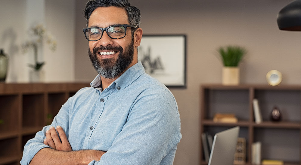Image of a man smiling in an office