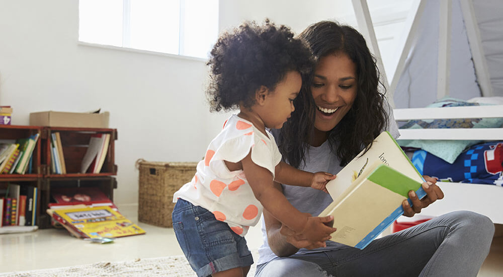 Image of a mother and small child reading together
