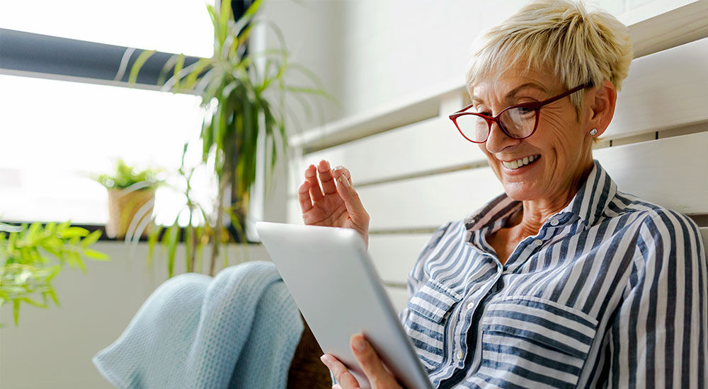 Image of an elderly woman with a tablet