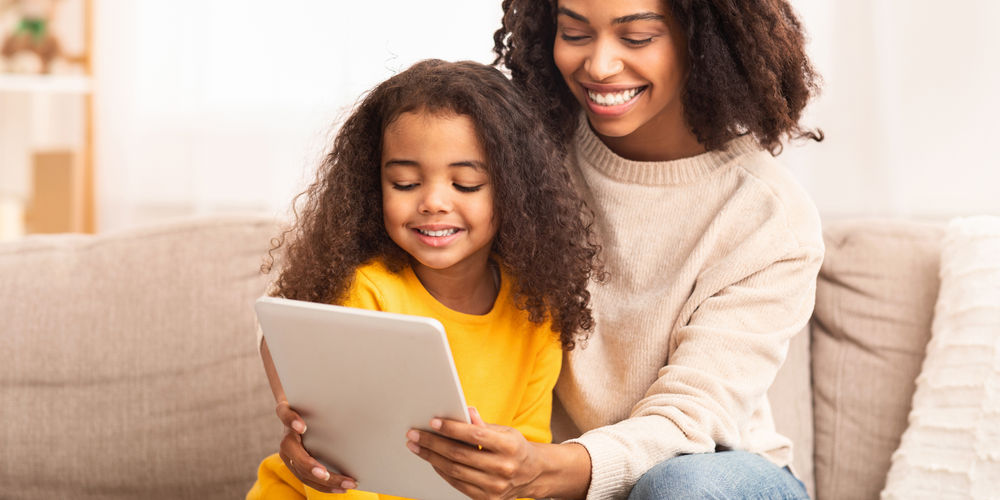 Mother attending an online therapy session with her daughter