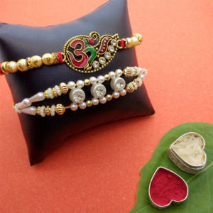 Divine Om and White Pearl Rakhi Set of 2