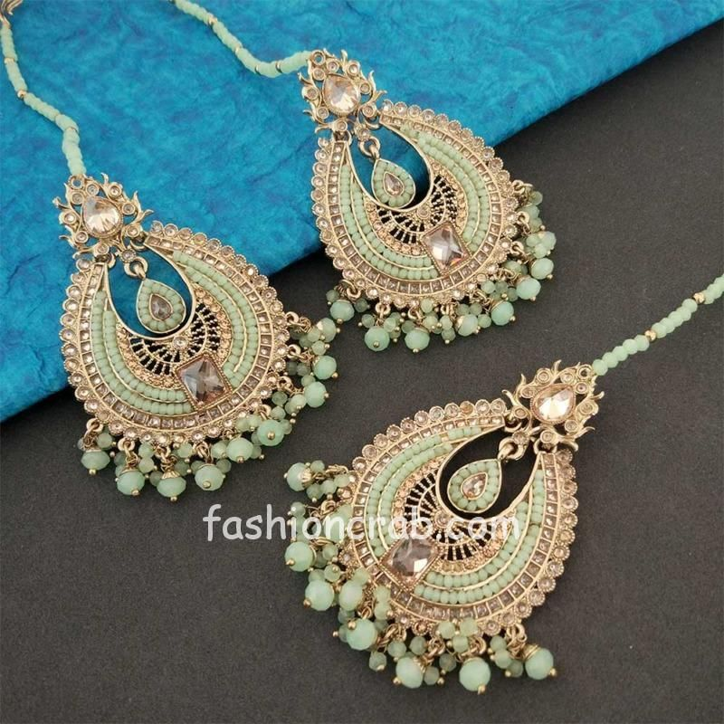 Gold Toned Handcrafted Light Green Pearl Earring Set with Maangtikka
