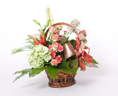 Basket of pink roses, Lilies & Carnations