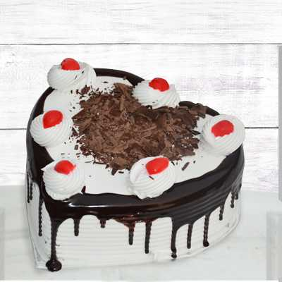 Send Housewarming Party Flowers Black Forest Heart Shape 1 Kg To Sister By Flower Delivery In