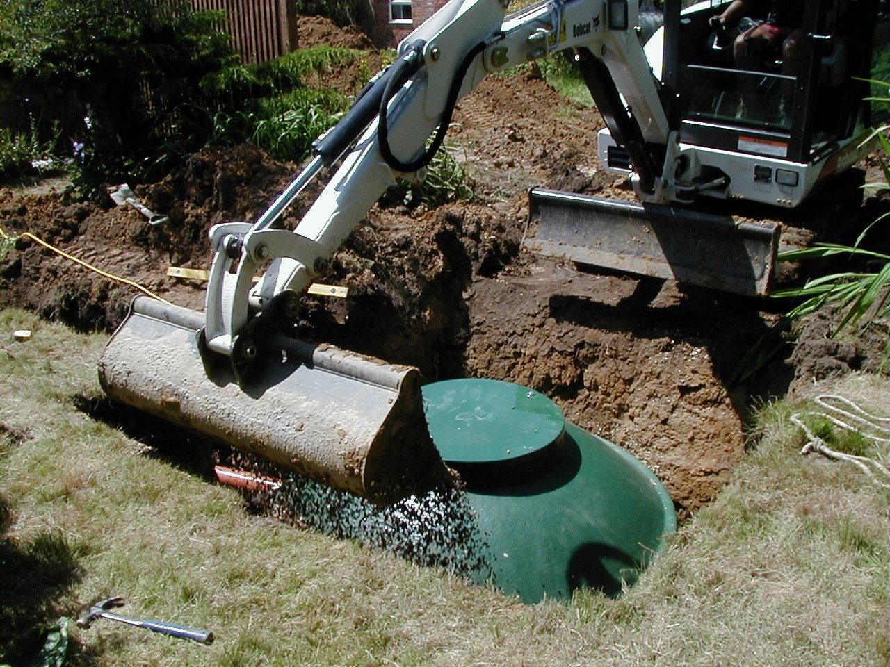 Image-showing-the-compact-installation-of-a-below-ground-WPL-Diamond-small-package-wastewater-sewage-treatment-plant-for-off-mains-drainage-at-a-domestic-application-home.