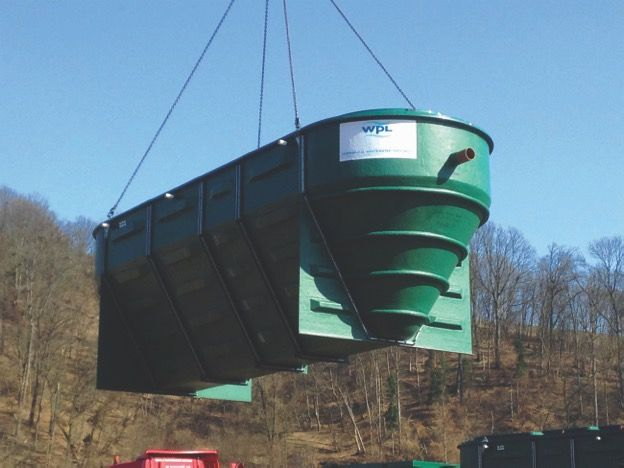 Image-of-a-custom-WPL-HiPAF-registered-®-package-wastewater-sewage-treatment-plant-for-off-mains-drainage-during-an-on-site-installation.