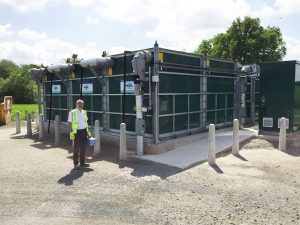 Image of WPL Technical Director Andrew Baird, next to the newly installed WPL Hybird SAF wastewater treatment solution at Sandbach wastewater treatment works for Unity Utility