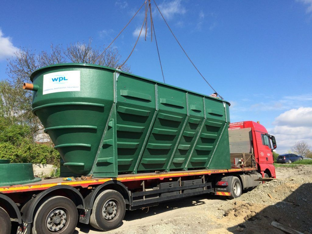 Photograph of the first WPLs first HiPAF packaged sewage treatment plant with submeraged areated filter (SAF) being transported in the Czech Republic's to the village of Dřínov