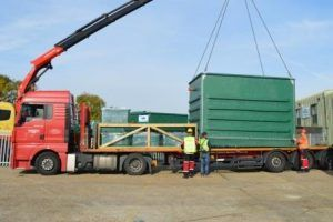 Image of WPL bespoke HiPAF® wastewater (sewage) treatment plant module being loaded for transportation
