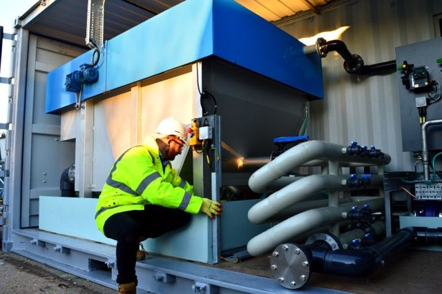 Image of WPL dissolved air flotation (DAF) wastewater treatment tank in a container being inspected by a WPL engineer