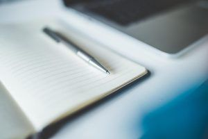Image of notepad and pen