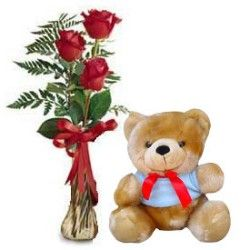 3 Roses flower in a glass vase with small teddy