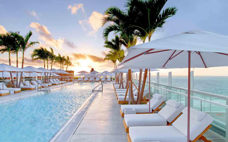 1 Hotel 's Beautiful Sunrise Beach Ansicht und Pool