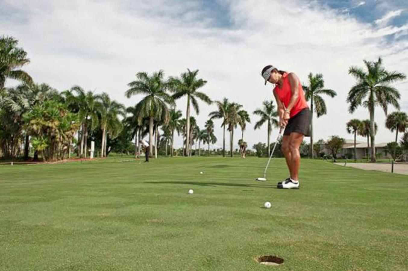 The putting green practice area at Country Club of Miami