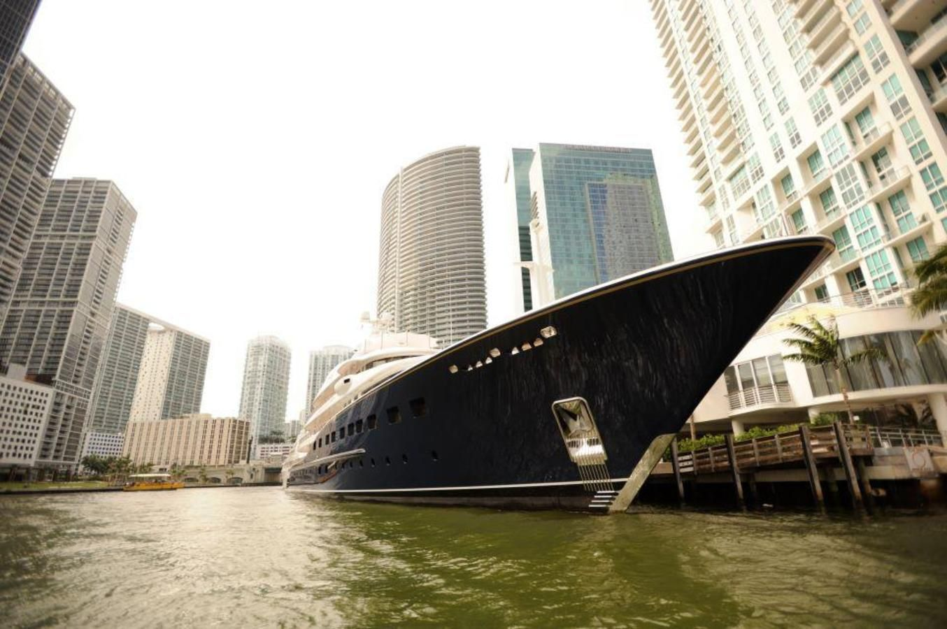 Luxury Yacht docked along the Miami River tour route in downtown Miami.