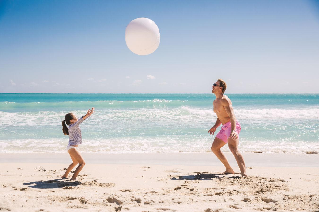 Beach ball action on the shoreline.