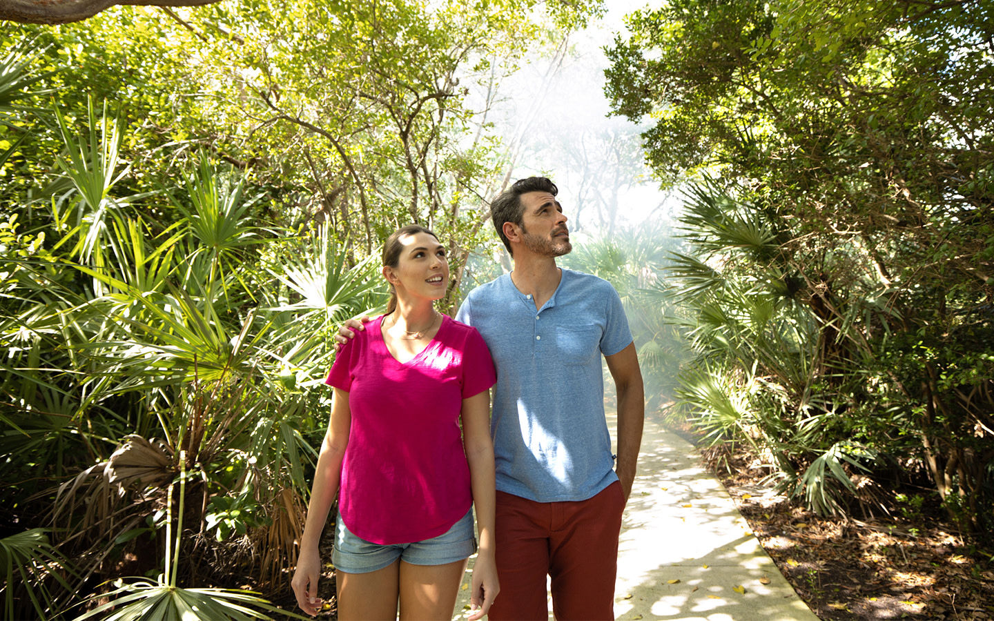 Couple walking in a nature trail at Crandon Park