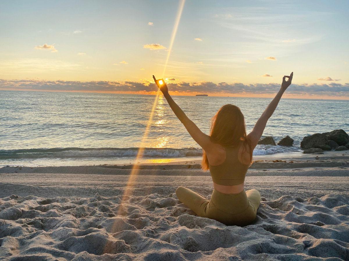 Girl on beach at sunrise