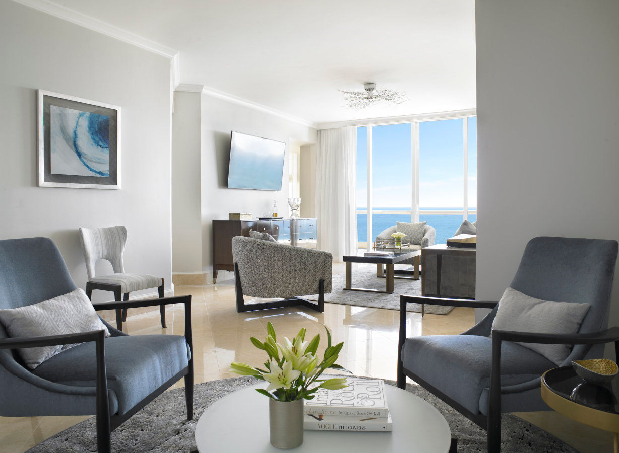 Grand Deluxe Three Bedroom Oceanfront Suite Living Room