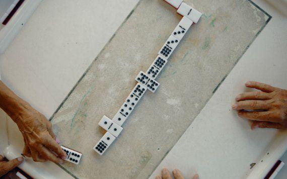 Men playing dominos