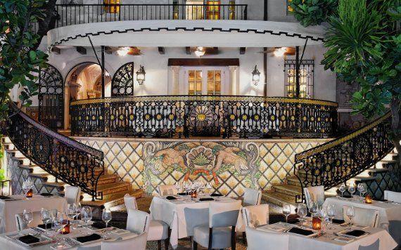 staircase and dining tables at Villa Casa Casuarina