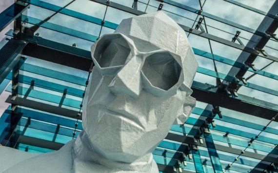 sculpture of man in Design District