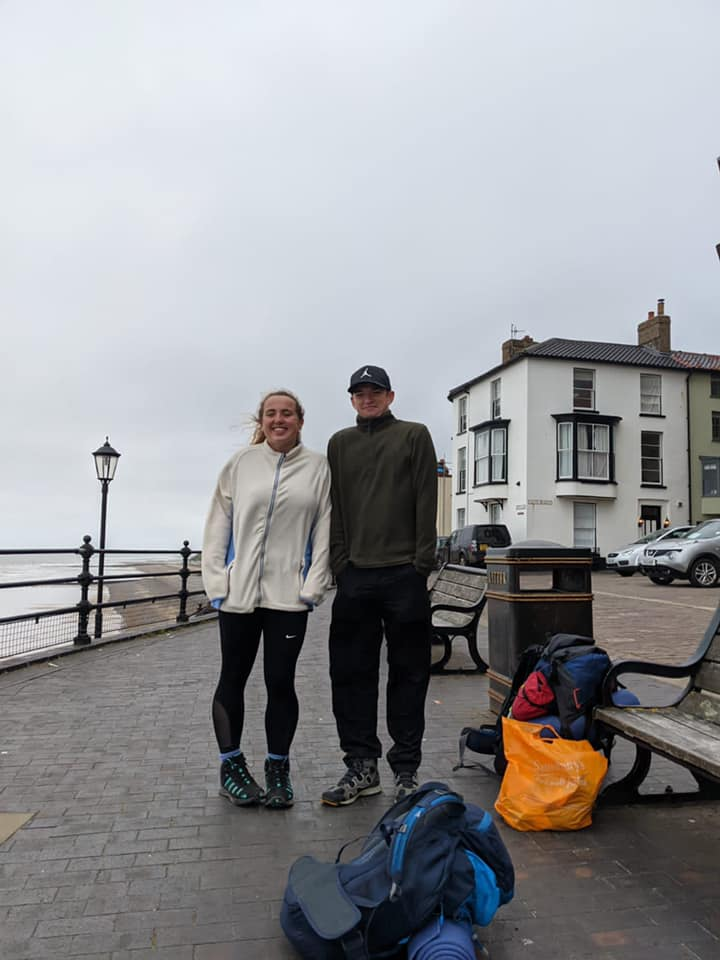 Arrived in Cromer on the East Coast, Megan and Myles standing in the rain