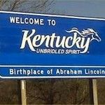 """Blue """"Welcome to Kentucky"""" street sign"""